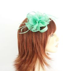 Peppermint Green Sinamay Fan, Flower, Loops, Beads and Feather Hair Fascinator finished on sprung clip: Amazon.co.uk: Beauty