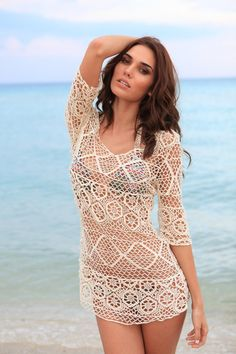 Pull your look together with the Bikini Luxe Gypsy Cover up! Wear this crochet beach cover up over your favorite tiny bikini to finish off your look in a luxurious way. This top is long enough to wear as a dress, or it can be tied up on one side for a fun look. The Crochet Cover up dress Up can also be worn off one shoulder! This is the perfect Bikini cover up for a hot day at the beach. #bikinicoverup #crochetcoverup #crochetcoverupdress
