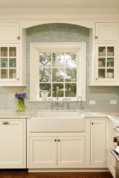 Like: cabinet style, trim/wood work above window; small tile as backsplash  Dislike: grout; overall tile color