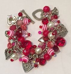 Handmade Valentine Charm Bracelet: Chunky Cluster Bracelet with Red, Pink and Pearl Beads and Heart Charms by RoyalStreetBoutique on Etsy