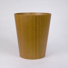"Here's a good looking wastebasket.  Canoe says it ""is the elevation of a prosaic household object into a rather handsome home accessory.""  Love that.  Also available in a dark walnut."