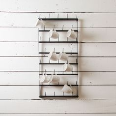Free up some much-needed cabinet space by using this distressed, black metal rack to displayyour favorite kitchen glasses, mason jars, or coffee mugs! This han