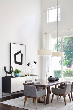 Article chairs surround the dining room table, which were designed by Watterworth-Alterman and crafted by California-based artisan Scott Prince of Hammer Fine Furniture | archdigest.com