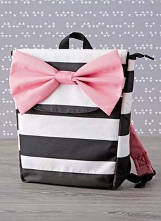 This backpack proves everything looks better with a bow. However, there's plenty more going for it, including roomy compartments and adjustable padded straps that make it easy to carry all of those school supplies. Look Fashion, Kids Fashion, Baby Supplies, School Supplies, Backpack Decoration, Toddler Backpack, School Bags For Kids, Hospital Bag, Kids Backpacks