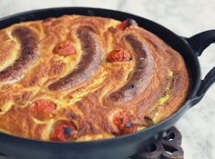 English Toad in the hole - Savoury Pudding with Sausage,Asparagus, and Tomato