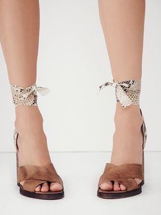 Sancerre Wrap Heel | Strappy block heel shoes with crisscross leather straps and a python-textured leather back with matching lace-up.   *By Free People   *Artisan crafted from fine leathers and premium materials, FP Collection shoes are coveted for their signature vintage aesthetic.