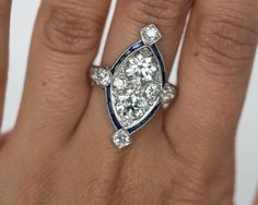 1920s Art Deco Sapphire Diamond Platinum Two Stone Engagement Ring For Sale at 1stdibs