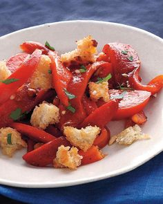 Fresh tomatoes and roasted red peppers are tossed in an almond and sherry vinegar dressing to create this side salad. Instead of roasting the peppers, use store-bought jarred peppers.