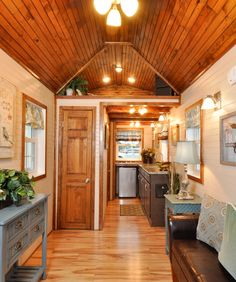 From Tiny House Building Company is the 272 sq. Pioneer, built for off-grid living. The upgraded interior features a king size loft and hickory cabinets. Tiny House Talk, Modern Tiny House, Tiny House Plans, Tiny House On Wheels, Tiny House Design, Tiny Houses For Sale, Little Houses, Small Houses, Mini Houses