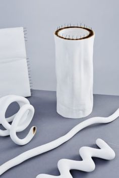 For Hot Wire Extensions, the designers of Studio Ilio, use nichrome wire and a material mixture of waste nylon powder from SLS 3D printing and cristobalite sand. By putting an electric current through the wire, it heats up to about 600 degrees Celsius (1112 degrees Fahrenheit), melting the nylon. The nylon bonds with the wire, creating a solid and seamless structure.