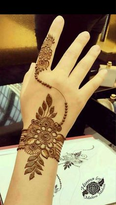 You've got an ocean of henna designs before you, and you can grab your most favorite one. Though it is a small body part, a henna on it looks simple yet elegant. Among all wrist tattoos, henna flower are believed to be the most well-known ones. Henna Hand Designs, Eid Mehndi Designs, Henna Flower Designs, Mehndi Designs Finger, Simple Arabic Mehndi Designs, Stylish Mehndi Designs, Mehndi Designs For Beginners, Mehndi Designs For Girls, Mehndi Design Photos
