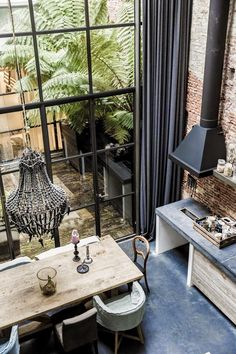 A loft home in Amsterdam -- brick wall, industrial stove hood, huge windows, weathered table, home design interior design house design house design Loft Interior Design, Interior Exterior, Exterior Design, Interior Architecture, Interior Doors, Kitchen Interior, Room Interior, Design Interiors, Interior Modern