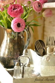 You can make an incredible vignette like this one by arranging beautiful blooms in a unique vessel, with other lovely decorative items. #flowers  #vignettes