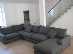 Bespoke corner and chaise unit based on the Freycinet, with a chaise on the right hand side, a sofa sectional (no arms) a corner and a large one armed sofa section of the left.