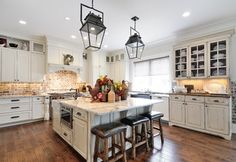 """Love these cabinet styles - the """"built in hutch"""", the counter top on the hutch , the brick back splash"""
