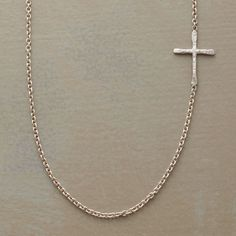 "LINKED CROSS NECKLACE -- Superfine links uphold a hand hammered cross set to one side of Rebecca Lankford's sterling silver necklace. Handcrafted in USA with a spring ring clasp. Cross is approx. 1/2""L"