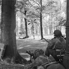 Men of HQ Troop of 1st Airlanding Brigade Reconnaissance Squadron at Wolfheze on the outskirts of Arnhem 18 September 1944. The man on the left is manning a PIAT.