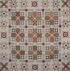 Civil war quilt reproduction, churn dash and nine patch blocks with flying geese sashing.  Pattern seen at Patchwork on Stonleigh
