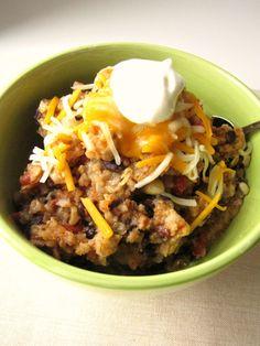 A complete meal in a bowl! These Slow Cooker Spicy Enchilada Bowls have black beans for protein, rice for grains, and lots of veggies! Easy weeknight dinner!