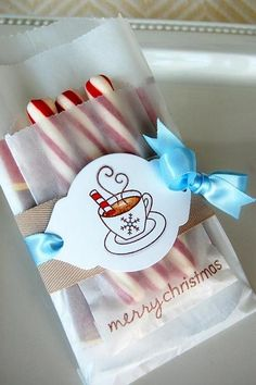 Merry Christmas cocoa wrap   {Merry Christmas} cocoa wrap  Stamps - Tremendous Treats  Ink - Basic Brown (SU), Copics  Cardstock - White  Die - Mat Stack 2  Other - glassine bags, Spring Rain ribbon, brown twill (unknown)