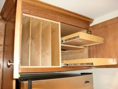 Above Fridge & Oven Solutions - Tray dividers beside a double set of pull out shelves creates usable storage above your refrigerator, making everything easy to get to while keeping it all organized. Kitchen Cabinet Organization, Kitchen Drawers, Kitchen Shelves, Kitchen Redo, Storage Cabinets, New Kitchen, Kitchen Remodel, Kitchen Design, Kitchen Cabinets