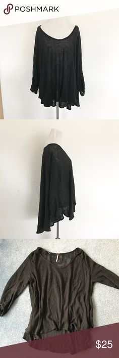 Free People Flowy Top Black Linen Flowy Tunic Top by Free People. The fit is very Drapey and loose. Would work for almost any size Small through Large. There are some small signs of wear as shown in the last photo, but you can't tell when wearing this. Priced to sell! Free People Tops
