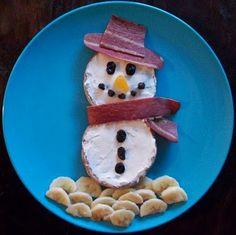 Frosty the snowman breakfast -- english muffin, cream cheese, turkey bacon, bananas, raisins