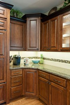 Kitchen with maple cabinetry corner and backsplash detail by Reese Construction, Inc Lincoln, NE