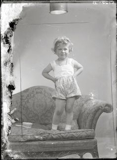 Princess Elizabeth of York, later Queen Elizabeth II. Ya gotta luv this pic she's standing on the couch!Probly jumping on it..