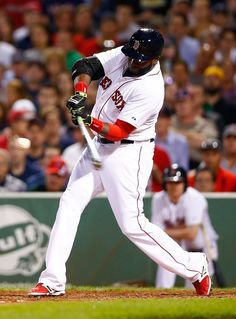 BOSTON, MA - AUGUST 16: David Ortiz #34 of the Boston Red Sox hits his second two-run home run of the game in the fifth inning against the Houston Astros during the game at Fenway Park on August 16, 2014 in Boston, Massachusetts. (Photo by Jared Wickerham/Getty Images)