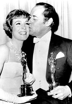 Image: 1965: Julie Andrews with her Oscar for ''Mary Poppins'' and Rex Harrison with his for ''My Fair Lady'' at the Academy Awards on April...