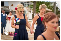 The beautiful bridesmaids walking in retro style in their navy blue dresses!