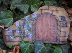 I like this painted rock idea for a garden. Makes you wonder who goes in and out among the greenery.
