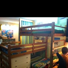 The triple bunk bed my husband made for our 3 boys.