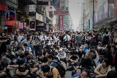 Pro-democracy protesters stand their ground in the Mong Kok district of Hong Kong on October 17, 2014