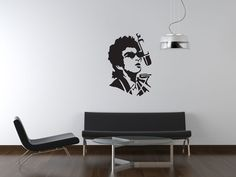 Bob Dylan Wall Sticker  Express yourself with this unique Bob Dylan wall sticker. Writer of countless classic songs, including 'Blowin' in the Wind', 'The Times They Are A-Changin'', 'All Along the Watchtower' and 'Like a Rollin' Stone' (which was named the best song of all time by Rolling Stone magazine in 2004), Dylan is one of America's most iconic musicians.