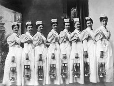 Only nursing majors would appreciate this as much as I do. :)  Nurses prepare for their night rounds in 1903.