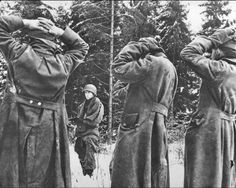German soldiers surrender to the US Army during Hitler's unsuccessful final thrust in the Ardennes in the last days of 1944. The failed German offensive depleted the very last combat-worthy reserves of manpower along with last significant supplies of fuel and weapons..