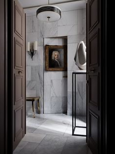 Paris apartment by Jean Louis Deniot : marble entry with jib door #design