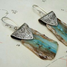 Raw Blue Opal Slab Earrings by melissamanley on Etsy: love the detail and upscale feel of the silver with detailing wrapped around the rough rock piece. Opal Jewelry, Copper Jewelry, Wire Jewelry, Boho Jewelry, Jewelry Art, Jewelry Accessories, Handmade Jewelry, Jewelry Design, Opal Earrings