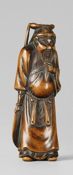 A boxwood netsuke of Kan'u. Early 19th century