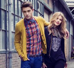 Francisco Lachowski—bright colours shirt, cardigan, jeans, and bow tie.