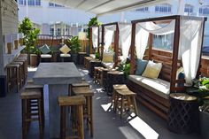 Seating and day bed on rooftop of Elixir Rooftop Bar in Fortitude Valley - 646 Ann St, Fortitude Valley