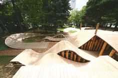 this undulating wooden structure on the japanese island of hokkaido has been conceived as a simulated forest.