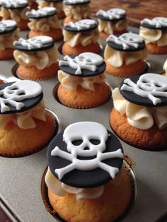 Some Halloween cupcakes with a sweet raspberry flavoured butter cream and a skull on top