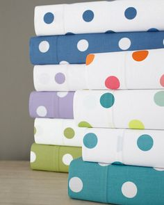 $18 for crib fitted sheet. Available in multi-dot. Good for colorful nursery theme.