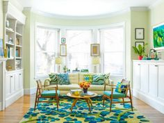 green living room with angela adams rug and danish modern chairs