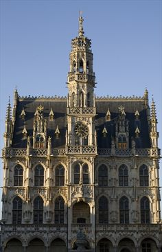 Stadhuis, Oudenaarde, Belgium. Built in c.1525-36 by the Brussels architect Hendrik van Pede; Flamboyant Gothic style; cupola in the shape of a crown topped by a gilded figure of Hanske de Krijge, Little John the Warrior, with a banner with the town's arms;