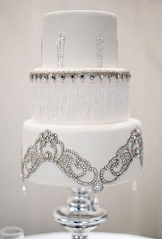 This is STUNNING!  This cake is decorated with the bride's collection of jewelry.