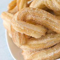 Plate of Churros by monkeybusiness. Plate of Churros Churros Sin Gluten, Köstliche Desserts, Dessert Recipes, Recipes Dinner, Mexican Food Recipes, Sweet Recipes, Mexican Desserts, Mexican Pastries, 3 Ingredient Recipes